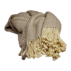 Alpaca Throw Blanket - Rustic yet refined, this stunning handcrafted sofa throw blanket is a total stunner. Featuring supremely soft 100% Baby Alpaca yarn, this decorative throw blanket looks amazing on a cozy couch or chair or makes an outstanding gift for the holidays.