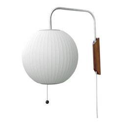 Modernica - Bubble Lamp, Ball Sconce - Designer George Nelson helped define midcentury style, and this adjustable wall sconce epitomizes his visionary aesthetic. The solid-walnut wall mount supports a translucent plastic globe that swivels left to right and up and down for ultimate flexibility. This design classic offers easy plug-in installation and soft, diffused light.