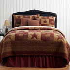 Country Bedding - NINEPATCH STAR QUILT ENSEMBLE --Decorate your master bedroom, guest room or country cottage with this handsome patchwork quilt. The new Ninepatch Star Quilt is part of the designer line by Ashton & Willow for VHC Brands, a leading manufacturer in the world of country style quilts. The Ninepatch Star Quilt Collection adds primitive country charm to any room with this richly designed bedding ensemble. The Quilt features burgundy and tan tonal shades in a block pattern with 5-point stars. Soft cotton plaid fabrics are skillfully pieced and extensively quilted using traditional methods. All pieces are 100% cotton, machine washable. Bed skirts have split corners. Heirloom quality you come to expect from the Victorian Heart Company`s Collection. Quilts have 100% cotton shell and fill. Luxury King Quilt measures 120x105 inches, King Quilt measures 110x97 inches, Queen Quilt measures 94x94 inches and Twin Quilt measures 70x90 inches.