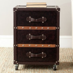 Safavieh Norman 3 Drawer Rolling Chest - Black/Brown - The days of steamer ships may be gone, but you can recapture the romance of sea-travel with the Safavieh Norman 3 Drawer Rolling Chest - Black/Brown. The metal and faux-leather construction make a luxurious statement in your home. Three drawers provide convenient storage for papers, books, or anything else you need to organize.About SafaviehConsidered the authority on fine quality, craftsmanship, and style since their inception in 1914, Safavieh is most successful in the home furnishings industry thanks to their talent for combining high tech with high touch. For four generations, the family behind the Safavieh brand has dedicated its talents and resources to providing uncompromising quality. They hold the durability, beauty, and artistry of their handmade rugs, well-crafted furniture, and decorative accents in the highest regard. That's why they focus their efforts on developing the highest quality products to suit the broadest range of budgets. Their mission is perpetuate the interior furnishings craft and lead with innovation while preserving centuries-old traditions in categories from antique reproductions to fashion-forward contemporary trends.