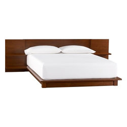 andes walnut bed - boutique hotel. Walnut veneer platform scales to new lo-heights integrating headboard nightstands that cantilever two stepped shelves each—one wide for books, one narrow with discreet cord cutouts for clock/light/dock. Just right height for pillow propping. Ledge extends around mattress, hovers over corner block feet. Substantial wood composite construction. Dreamy price. Mattresses available, sold separately. Also in hi-gloss white lacquer. Learn about the designer, Mark Daniel, on our blog.- Designed by Mark Daniel of Slate Design- Walnut veneer over wood composite- Integrated headboard nightstands with two shelves each- Ultra-low platform cantilevers over base- For use with mattress only- Made in Vietnam- See dimensions below