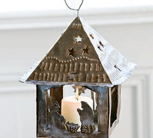 Primitive Nativity Lantern - Depicting a lovely nativity scene in a folk art style silhouette, our primitive recycled steel lantern descends from apex hook to allow for easy placement wherever a distinctive touch of light is needed. The small candle you place inside will illuminate the serene scene while casting unique and delightful wall shadows.