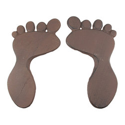 Pair Of Cast Iron Footprint Stepping Stones Antique Finish - This cool pair of footprint stepping stones is designed to give your garden path a unique and delightful look. Made from cast iron, each of the footprints measures 13 1/2 inches long, 7 1/2 inches wide. They have an antiqued brown enamel finish that gives them a rustic, aged look. You`ll get a left foot and a right foot. They make a great housewarming gift, and are perfect to add to new landscaping projects.
