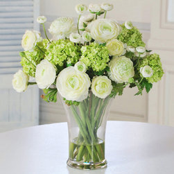 "Frontgate - Ranunculus Floral Arrangement with Glass Vase - Long-lasting permanent botanical means it will never wilt, dry up, or shed its petals. Crafted with high-grade polyester fabric. Hand-arranged blooms and leaves. Each bloom is handpainted; each petal is hand-curled. Filled with acrylic ""water"". Invest in a permanent display of your favorite springtime florals with the natural looking Ranunculus in Glass Vase Floral Arrangement. A stunning blend of creamy white and bright green, this vase makes an irresistible centerpiece, sure to be enjoyed year-round.  .  .  .  . Filled with acrylic ""water' . Feather dust . Created by artist Matt Wood."