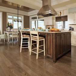 Mirage Maple - This Maple hardwood offers highly decorative grains and a beautiful depth to the rich browns in this contemporary kitchen.This floor is featured in the color Savannah.