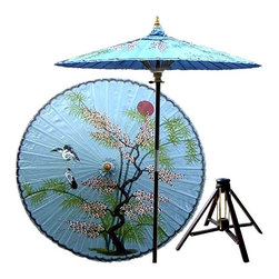 Oriental Unlimted - Asian Splendor Patio Umbrella in Andaman Blue - Includes Bamboo stand. Handcrafted and hand-painted by master artisans. 100% Waterproof and extremely durable. Umbrella shade can be set at 2 different heights, 1 for maximum shade coverage and the other for a better view of the shade. An optional base, which secures the umbrella rod and shade against strong winds and rain. Patio umbrella rod and base is constructed of stained oak hardwood for a rich look and durable design. Umbrella shade is made of oil-treated cotton. Minimal assembly required. Canopy: 76 in. D x 84 in. HThis one-of-a-kind patio umbrella is completely handcrafted with a beautiful hand-painted design of an Asian landscape on top.