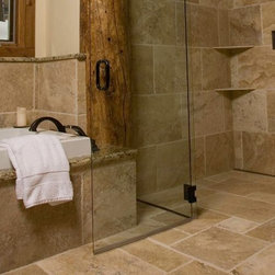 """Continuous Floor Tile in Rustic Shower - The tilework in this modern rustic bathroom is allowed to shine when a linear drain is positioned against the interior wall of the shower. Continuous floor tile adds beautiful consistency to the design and helps integrate the shower into its environment. Any flooring material can be used with this system. Materials like epoxy or urethane, sheet vinyl, tiles of any material or thickness, solid slabs or even stained and colored concrete have been successfully used. Different spacer sizes can accomodate total finished flooring thicknesses ranging from 1/2"""" to 2 1/2""""."""