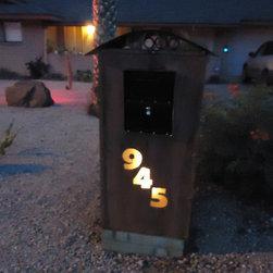 Black Bull Fabrications - lighted rustic metal mailbox enclosure.