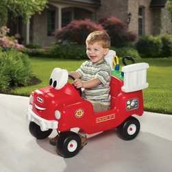 MGA Entertainment - Little Tikes Spray & Rescue Fire Truck Riding Push Toy Multicolor - 616129 - Shop for Tricycles and Riding Toys from Hayneedle.com! When a 3-alarm emergency requires immediate applications of considerable amounts of fun your little one is prepared with the Little Tikes Spray & Rescue Fire Truck Riding Toy. This rugged riding toy is molded in vintage fire-truck style from durable plastic and features the classic foot-to-floor ride to work those legs. From there however this riding toy ups the ante by featuring a water tank that can be pressurized with a pump handle and then sprayed through an attached fire hose. When it's time to fill the water tank again and again the tank can be easily removed for refill. Your little one's imagination will get a kick start when they have a working pumper truck at their disposal. This riding toy has a weight limit of 50 lbs and is recommended for children from 1-1/2 to 5 years old.About Little TikesFounded in 1970 the Little Tikes Company is a multi-national manufacturer and marketer of high-quality innovative children's products. They manufacture a wide variety of product categories for young children including infant toys popular sports play trucks ride-on toys sandboxes activity gyms and climbers slides pre-school development role-play toys creative arts and juvenile furniture. Their products are known for providing durable imaginative and active fun.In November of 2006 Little Tikes became a part of MGA Entertainment. MGA Entertainment is a leader in the revolution of family entertainment. Little Tikes services the United States from its headquarters and manufacturing facility in Hudson Ohio but also operates several manufacturing and distribution centers in Europe and Asia.