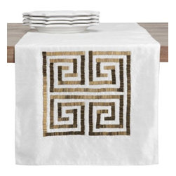 Z Gallerie - Greek Key Runner - Embellish your tablescape with metallic detailing and a classically inspired design with our Greek Key Runner. Created out of a crisp white poly-satin, metallic gold hued beaded detailing in the shape of Greek Keys adorns each side for an added layer of luxe.  Sophisticated and chic our Greek Key Runner is a stunning complement to a wide variety of tablescapes and décor settings.  Layer with rich hues of gold for a complementary pairing, or consider pairing with white dinnerware for an effortlessly layered look. Exclusive to Z Gallerie. Shown with our Quadra Dinnerware.