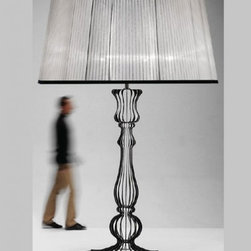 """8006 Victoria Floor Lamp - The 8006 Victoria Floor Lamp has been designed and made in Italy by the manufacturer Italamp. 8006 Victoria floor light is a contemporary lamp made of metal, fabric and plexiglas. This modern floor lamp is an impresive presence in any kind of room, bringing a touch of nowelty to the environment where it is placed. Available in a single size with its trapezoid shape, Victoria lamp consists of a metal structure which sustains its anthracite plexiglas body and finishes. 8006 Victoria has its lampshade in light grey or dark grey. The light fixture has a diffused light and when is turned on the lamp diffuses a parade of light with bright personality. Illumination is provided by E26, 100W Halogen, or 20W Energy Saving, or 10W LED bulb (not included).     .proddesc p{font-family: Verdana, sans-serif; font-size:8pt!important;}   .pdtable{font-family: Verdana, sans-serif; font-size:8pt!important;padding:10px;} Product Details: The 8006 Victoria Floor Lamp has been  designed  and made in Italy by the manufacturer Italamp. 8006 Victoria floor light is a contemporary   lamp made  of  metal, fabric and plexiglas. This modern floor lamp is an impresive presence in any kind of room, bringing a touch of nowelty to the environment where it is placed. Available in a single size with its trapezoid shape, Victoria lamp consists of a metal structure which sustains its anthracite plexiglas body and finishes. 8006 Victoria has  its lampshade in light grey or dark grey. The light fixture has a diffused light  and when is turned on the lamp diffuses a parade of light with bright personality.  Illumination is provided by E26,  100W Halogen, or 20W Energy Saving, or 10W LED bulb (not included). Details:                         Manufacturer:            Italamp                            Designer:            Italamp                            Made in:            Italy                            Dimensions:                        Diameter: 78.8""""(200.2cm) X Height: 118."""
