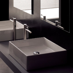 "Scarabeo - Modern Square White Ceramic Bathroom Vessel Sink - This square white ceramic bathroom sink by Scarabeo is designed and made in Italy. Sleek modern above counter vessel sink comes without overflow and has no faucet holes. Sink dimensions: 18.10"" (width), 5.50"" (height), 18.10"" (depth)"