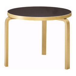 Artek - Round Table 90B by Alvar Aalto - Artek - Sometimes less better as is the case for the Table 90B by Alvar Aalto with the signature curved leg technology and simple round table top. The 90B is not fancy and sports nothing extra. The simple beauty of the design and warmth of the natural birch is all that is needed to be a statement of elegance and functionality. The 90B is available with a black linoleum, white laminate or natural clear lacquer table top.
