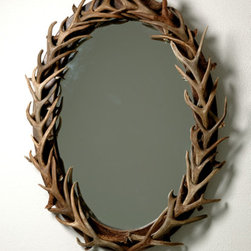Oval Antler Mirror, Large - I'd place this antler mirror in an entrance way, or even the bathroom of a rustic cabin. I love the pattern the repetitive antlers make.