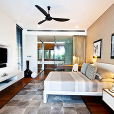 Contemporary Bedroom by DESIGN INTERVENTION