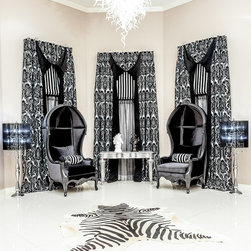 Neo French Baroque with a Gothic Twist - We will design and fabricate for all custom styles including a Neo French Baroque that has a Gothic Design element to it.  We designed a tuxedo panel with a high pull up corner to show a contrast reveal of black velour lining.  The large motif print of a black and silver damask was the perfect selection for these panels.  All fabric for this project was a Customer's Own Material (COM).  Coordinating Roman od accent fabric tied in all the elements needed for this room.  A sheer with black and a grey overlay further add drama to this room.