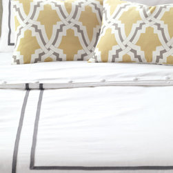 Davis Duvet Cover - Niche's Davis bed set introduces traditional style to an urban environment. A pure white duvet cover is outlined with a charcoal colored ribbon, decorative pillows add textural contrast, and a graphic pattern brings freshness with its dandelion print.