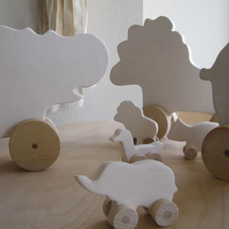Large Marching Menagerie Wheeled Animal - We are huge fans of toys that don't need to be put away. These wheeled animals are as cute for the little one to play with as they are for a part of the nursery decor.