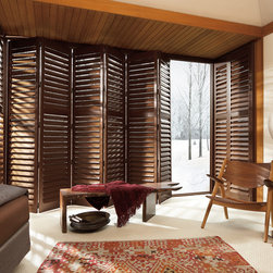 NewStyle Hybrid Shutters with Bi-Fold Track System - These hybrid shutters are on a track system, making them easy to open and close. You can use them to block out the heat on the side of the room that faces the sun.