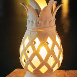 "Frontgate - Ceramic Pineapple Outdoor Lantern - Ideal for a dining table or side table during evening entertaining. Suitable for outdoor or indoor use. Bring indoors during freezing temperatures. Frontgate exclusive. Wipe clean with a soft, damp cloth. With an exquisite take on the communal symbol of friendship and hospitality, this handmade Ceramic Pineapple Lantern adds artistry to outdoor accent lighting. The intricately detailed piece features a removable top to insert and light a 3"" x 6"" candle (sold separately). . . . . ."
