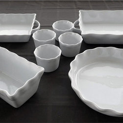 None - White Stoneware Bakeware 8-piece Set - Bake almost anything with this eight-piece bakeware set. This set is constructed of white stoneware and features a beautiful design.