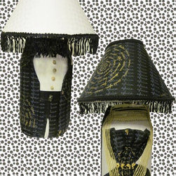 I Got your Back - TEDDEEZtm Lamp  I Got Your Back is multiside, glass base adorned in African print and brocade fabric. Black print has countries of Africa written in a gold circular form and the name Africa written repetitively in a vertical form. The dress side is accessorized with gold shawl, white pearls and gold Nefertiti bust. Now turn it around and black pants, jacket and bow tie is accessorized with sea shell buttons and elephant. Lovely matching shade has black tassels on white side. Can be displayed four ways by turning just the shade or by turning just the base. Excellent for any couple you whose face you want to light up through beauty.