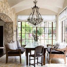 Mediterranean Dining Room by Landmark Building Inc