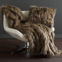 Peacock Alley - Bella Throw Blanket in Mocha - Bella, the sensual faux fur lounge throw and square pillow is more than just a conversation piece! This sexy fur throw will spice up any bedroom, chaise lounge or living area. Bella is sure to give any space an uber-modern and sensual feel. Features: -Color: Mocha. -Material: 100% polyester. -Imported, professional care recommended.
