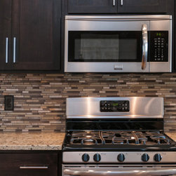 6513 Hitching Post - Gourmet Kitchen with stainless steel appliances. The backsplash is Dune, glass and stone mosaic.