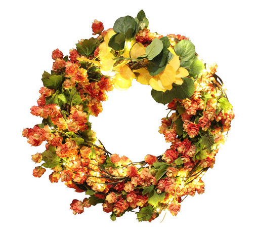 The Firefly Garden - Colorful Colorado - Illuminated Floral Design - This bountiful wreath of orange Hop blossoms is a perfect way to usher in the Fall Season. Accented with warm white and amber lights this arrangement will adorn your front door or entry as guests arrive for Thanksgiving and other Fall celebrations. 20 inches in diameter. Uses 3 AA batteries.