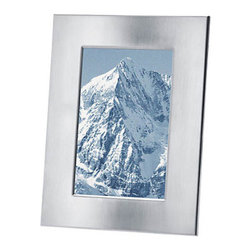 "Blomus - FRAMY Picture Frame - Your favorite memory doesn't need a lot glitz for them to shine. The FRAMY Picture Frame keeps the focus on your photo with minimal, clean lines in brushed stainless steel. This frame houses one special 4"" x 6"" photo."