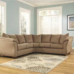 Signature by Ashley - Darcy Sectional in Mocha Fabric - 2 Piece Sectional. Contemporary Design. Plush Upholstered Arms. Mocha Fabric Upholstery. Pillow Back Cushions. Fixed Back. Loose Seat Cushions. CA117 Fire Retardant Foam. Black Bottom Dust Cover. Plastic Triblock Feet. Pieces attach with Connecting Brackets. Durable Frame Construction. Seat and Back Spring Rails cut from .875 in. Thick Hardwood. Corners are Glued, Blocked and Stapled. Upholstery pre-approved for wearability and durability against AHFA Standards. Cushion core constructed of low melt fiber wrapped over high quality foam. 100% Polyester. Spot clean with water based cleaner.