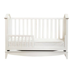 Franklin & Ben - Franklin & Ben Arlington 3-in-1 Convertible Crib in White - Franklin & Ben - Cribs - B6401W - The Arlington 3-in-1 convertible crib with a toddler rail is sure to take care of your little one's bedding needs. Its minimalist design features clean lines and delicate curves that can blend with any decor setting. This pristine white crib also comes with a toddler conversion rail which helps convert the crib into toddler and day bed as your baby grows older. It is flawlessly hand finished in a non toxic, multi-step staining process. The crib is made from American poplar hardwood and solid birch veneers.