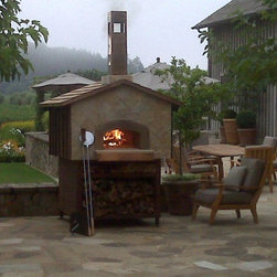 Mugnaini Wood Fired Ovens - Mugnaini Pizza Ovens - Outdoor Oven - Find the perfect outdoor oven for your backyard, garden, poolside or patio. Mugnaini outdoor pizza ovens are the ideal centerpiece for alfresco dining and entertaining. Pick from a variety of shapes and sizes, and create the ultimate open-air kitchen with a Mugnaini wood fired oven. www.mugnaini.com