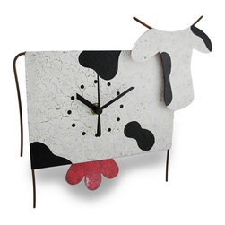 Black/White Cow Wall Clock Udder Pendulum - This cow clock adds an `udderly` adorable accent to your home, featuring a swinging pendulum that is sure to make you smile. It is hand crafted from recycled metal materials and measures 10.5 inches (27 cm) long, 9.25 inches (24 cm) tall, and 2.5 inches (6 cm) deep. The clock features a quartz movement and runs on 1 AAA battery (not included). A hand-painted crackle finish completes the feel of home-style craftwork. This piece makes a unique accent as a useful, decorative timepiece and it makes a wonderful gift for cow collectors.
