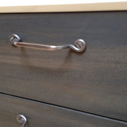 Adele - This Credenza is shown in white with darkened a walnut face, Custom cast bronze legs and hand forged pulls