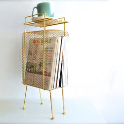 Midcentury Magazine Rack, Gold by Charlie's Nest - Gold is a good fall color, and this magazine rack would inject a nice shot of it in a living room.