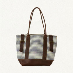 Leather & Canvas Weekend Bag - Lovingly salvaged from 1940s ticking fabric, this tote was made to be filled with a fresh farm stand haul. Imagine it overflowing with sunflowers and ears of corn.