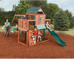 Swing-N-Slide - Swing-N-Slide Winchester Wood Swing Set Multicolor - PB 8210 - Shop for Swings Slides and Gyms from Hayneedle.com! Build a fun-filled adventurous playhouse for your kids and all their friends with the Swing-N-Slide Winchester Wood Swing Set. This set is a do-it-yourselfer's dream because all the pieces are included and arrive in one box. Even the necessary lumber is pre-stained- pre-cut and securely packed. All you need are a few common household tools and some free time to put it all together. Illustrated instructions are included to help you on your way as well as an instructional DVD. This swing set uses the award-winning Rapid-LOC bracket system for extra stability and safety. There are three play decks totaling 32-square-feet and one deck is even covered with a roof and features a window. Kids will love the 8-foot slide swings 2-for-fun ride rock climbing wall and more. This product carries a 5-year warranty. This warranty is valid only if the product is used for the purpose for which it was designed and installed at a residential single family dwelling. Swing N Slide products are rated and tested for residential use only. Swing Set Includes: All necessary screws nuts bolts washers bits etc. for assembly All necessary Rapid-LOC brackets for easy assembly 2 swing seats and 4 swing hangers 1 window frame 1 awning 2 roof support plates 1 awning support 1 steering wheel 4 swing hangers 3 metal rungs 8 climbing rocks 4 safety handles 2 swings 1 coolwave slide 1 2-for-fun ride 164 pieces of pre-cut lumber 4 pieces plastic coated lumber Tools You Will Need: Electric drill Hammer Tape measure Safety glasses and dust mask Carpenter's square About Swing-N-SlideFounded in 1985 Swing-N-Slide was America's first manufacturer of do-it-yourself wooden playground products. This remarkable company designs manufactures and distributes residential and commercial play sets across the nation. Committed to safety and driven by a desire to provide compliant fun and va