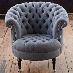 "Regina Andrew - Regina Andrew Gray Wool Tufted Tub Chair - Regina Andrew takes a classic approach with this tub chair by dressing it up in handsome tufted gray wool and nickel nailhead trim. With casters on the bottom of its turned wood legs, this armchair can easily be moved to join any conversation. 33""W x 36""D x 32""H. Wood legs. Wool upholstery. Hand spot or professionally clean."