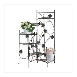 n/a - Ivy-design staircase plant stand - Airy strands of ivy grace this staircase style plant stand.  Six shelves place plants at graduating heights, creating a dramatic display of greenery !  Metal .  Some assembly required.  Plants and pots not included.