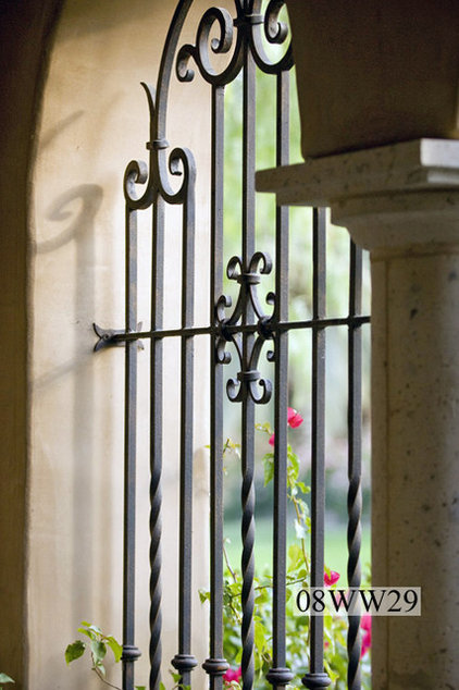 Row Of Windows With Wrought Iron Grills On Side Of Spanish Style ...