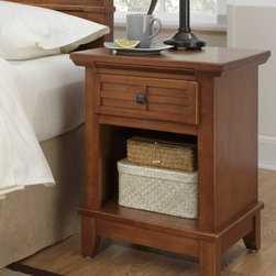 Home Styles - Arts and Crafts 1 Drawer Nightstand - Mission Styling at its best! The Arts and Crafts nightstand embellishes typical mission styling with framed drawer showcasing raised wood, lattice moldings and slightly flared legs. Square Brushed Nickel Hardware. Finished in a warm Cottage Oak finish over hardwood solids and hardwood veneers, simplistic yet detailed design makes it an ideal piece for any bedroom setting. The top of the hidden pull-out tray features a scratch and stain resistant finish. Features: -Arts and Crafts collection. -Hardwood solids and engineered wood construction. -Embellishes typical mission styling. -Top of the tray features a scratch and stain resistant finish. -Raised wood, lattice moldings and slightly flared legs. -Square brushed nickel hardware. -Ideal piece for any bedroom setting.