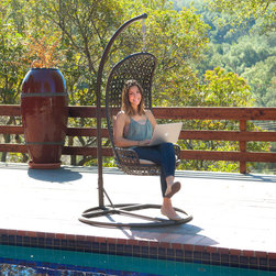 None - Brown Wicker Outdoor Swinging Chair - Enjoy warm summer days in the comfort of your own backyard with this fun outdoor swinging chair. Made of stylish brown wicker,this steel-framed chair features comfortable beige cushions and is weather and UV-protected for long-lasting use.