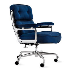 """Herman Miller - Eames® Executive Chair in Messenger Fabric - Also known as the Time-Life Chair, this iconic piece was originally created for the executive floors of New York City's Time-Life Building in 1960. How those lucky executives were able to get an Eames chair designed just for them began with the Time-Life Chairman, Henry Luce. In 1959, Charles Eames asked Luce for photographs from the Time-Life archive to be used in a slideshow he was creating for the U.S. pavilion at the Moscow World Exhibition. Luce agreed, as long as Eames promised to return the favor one day. In 1960, Eames made good on that promise, and 50 years later, the world is still enjoying the results of that arrangement. This chair is an authentic, fully licensed product of Herman Miller®, Inc. Eames is a licensed trademark of Herman Miller. Made in U.S.A. This chair tilts, swivels and has a height-adjustable seat. Generously sized and comfortable, it has a 4.5""""-thick seat cushion and 3""""-thick back cushions."""