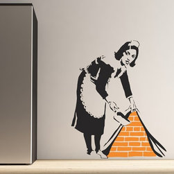 Binary Box - Banksy Maid Wall Sticker - The Banksy Maid Wall Sticker is based on a design by UK graffiti artist Banksy. It features an old-fashioned maid sweeping some rubbish under your wallpaper. Perfect for plain white walls, this wall sticker creates a 3D illusion of the bricks being exposed behind the paper. Express some of your personality with this humorous, characterful wall sticker that makes a bold and stylish statement in any room.