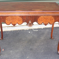 Antique French Desk-mid 1800s - Beautiful antique burled antique French desk, from mid 1800s. Alot of stunning burled inlay. Cabriole legs. One large draw which is as deep as the entire table and made of tigar oak. Top is high gloss finish and rest of table is in a semi gloss. This table isnt perfect as a few small areas of veneer had been replaced over the years.