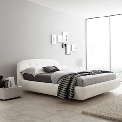 Rossetto - Rossetto | Eclipse Platform Bed - Soft neutral tones of White leather or textured Gray fabric accentuate the delicate stitching of Rossetto's Eclipse Platform Bed. The tufted headboard features a gently rounded silhouette while the fully upholstered design has an inviting, cushioned effect. Clear base legs create a floating illusion. Designed for a mattress only. Select Queen or King size in White Leather or Gray Fabric.