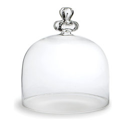 Cero Dome for Tall Stand - A simple shape with an artisanal quality captured in the curves of its high knob, the Cero Dome is designed to suit the matching Tall Stand e but whenever you want to set apart a high-end treat or a small treasure, this glass cloche can rest on a surface to shield that item from dust and emphasize its special quality.  This piece is handmade from clear Romanian glass.
