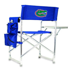 """Picnic Time - University of Florida Sports Chair in Navy - The Sports Chair by Picnic Time is the ultimate spectator chair! It's a lightweight, portable folding chair with a sturdy aluminum frame that has an adjustable shoulder strap for easy carrying. If you prefer not to use the shoulder strap, the chair also has two sturdy webbing handles that come into view when the chair is folded. The extra-wide seat (19.5"""") is made of durable 600D polyester with padding for extra comfort. The armrests are also padded for optimal comfort. On the side of the chair is a 600D polyester accessories panel that includes a variety of pockets to hold such items as your cell phone, sunglasses, magazines, or a scorekeeper's pad. It also includes an insulated bottled beverage pouch and a zippered security pocket to keep valuables out of plain view. A convenient side table folds out to hold food or drinks (up to 10 lbs.). Maximum weight capacity for the chair is 300 lbs. The Sports Chair makes a perfect gift for those who enjoy spectator sports, RVing, and camping.; College Name: University of Florida; Mascot: Gators; Decoration: Embroidered; Includes: 1 detachable polyester armrest caddy with a variety of storage pockets designed to hold the accessories you use most"""